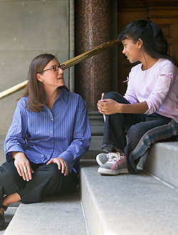 CASA volunteer speaking with child